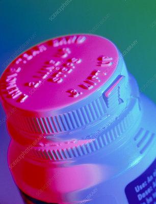 Safety cap on a medicine bottle