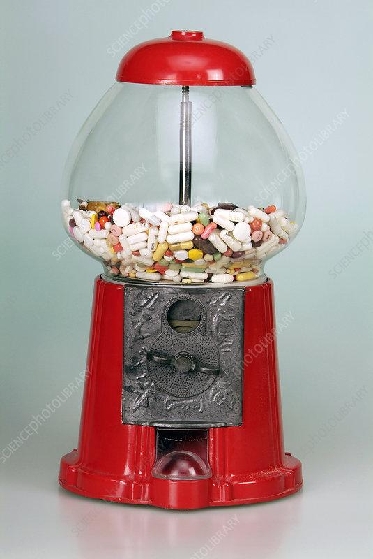 Drug pills in a sweet dispenser