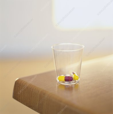 Drug capsules in a beaker