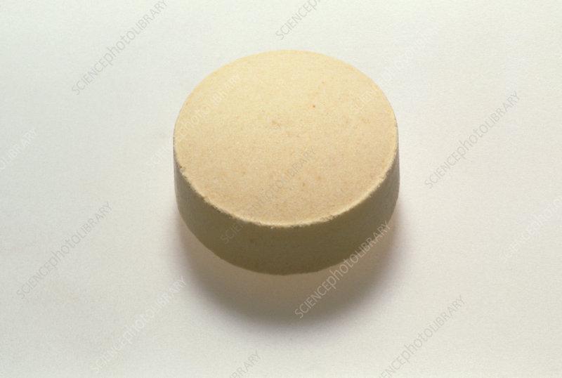 A pill of folic acid (vitamin B complex)