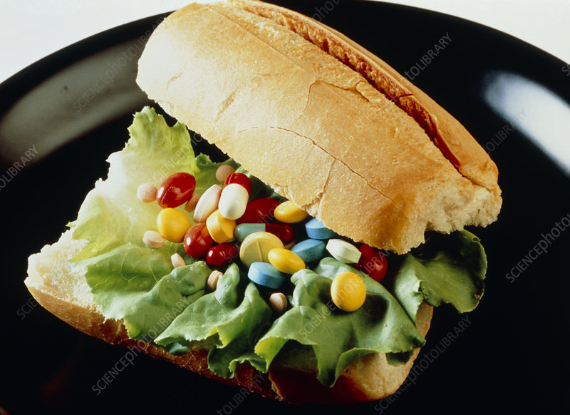 Abstract image of vitamins pills in a sandwich