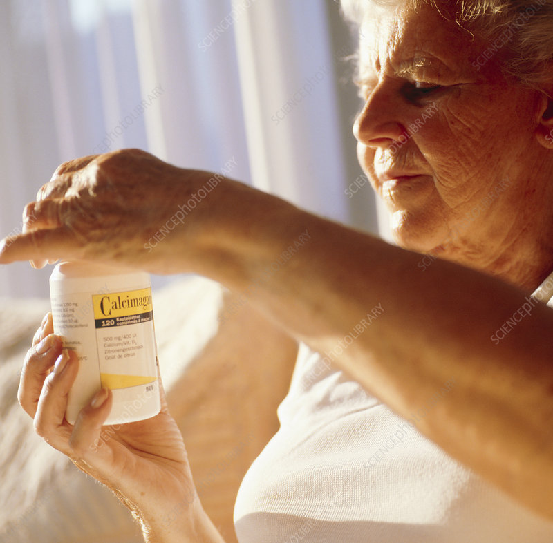 Elderly woman taking calcium pills