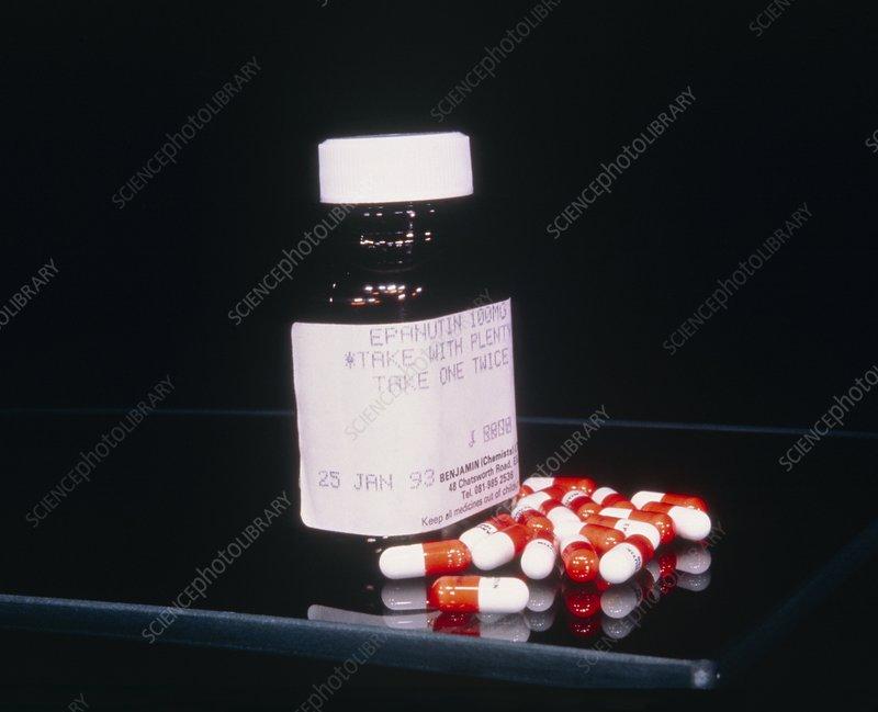 A bottle containing anticonvulsant drug pills