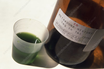 Bottle and beaker containing the drug methadone