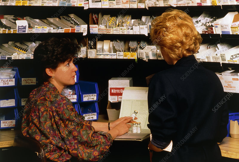 Hospital pharmacist dispenses a drug