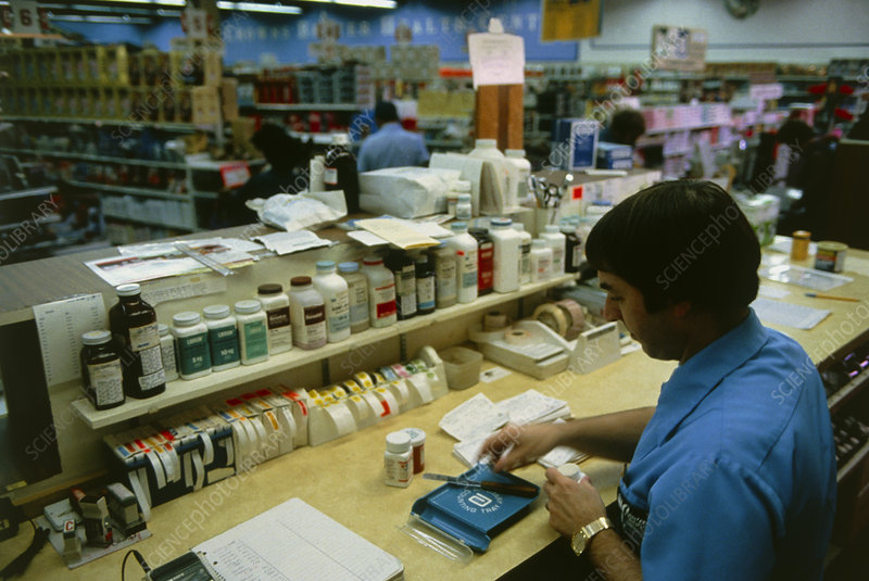 Pharmacist compiling a drug prescription