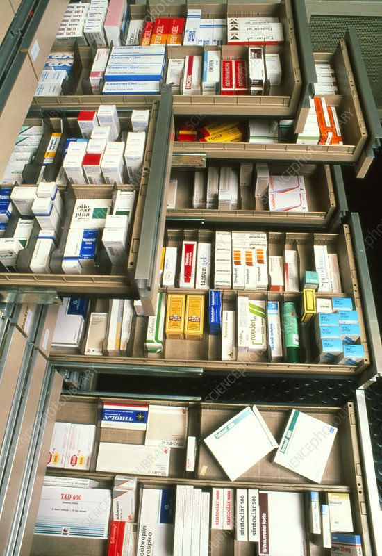 Several drawers in a pharmacy containing drugs
