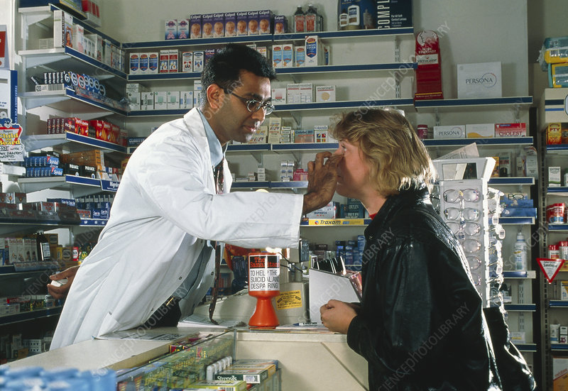 View of a pharmacist examining a woman's eye