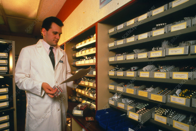 Pharmacist filling drug orders in a dispensary
