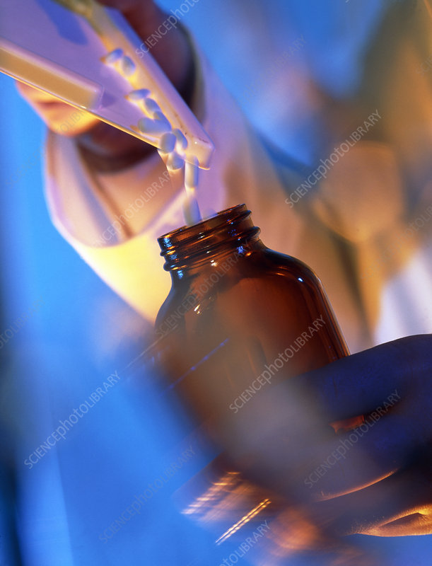 Pills being poured into a bottle after counting