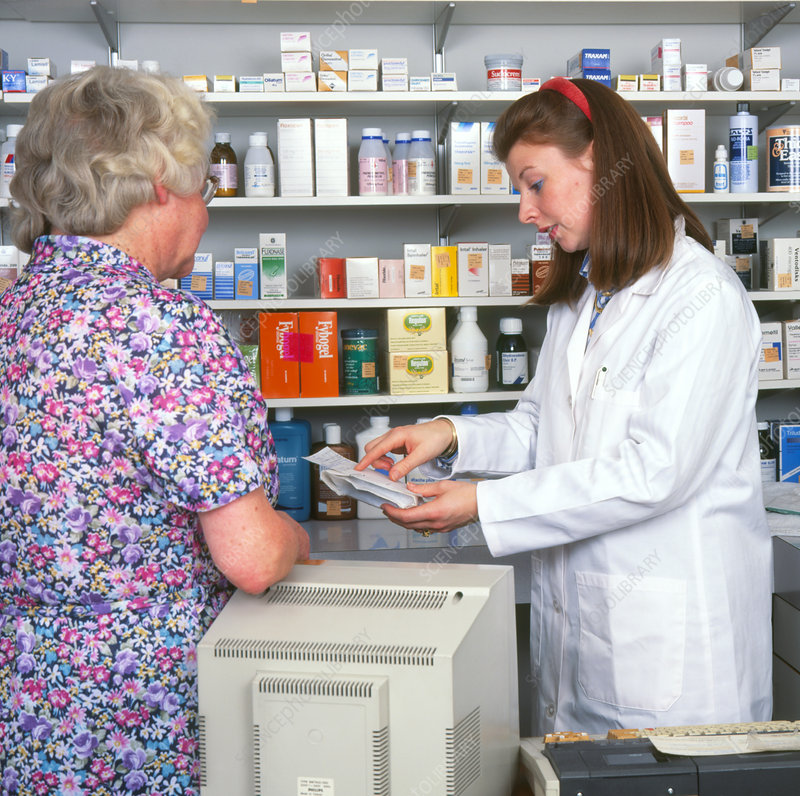 Pharmacist discusses prescription with a patient