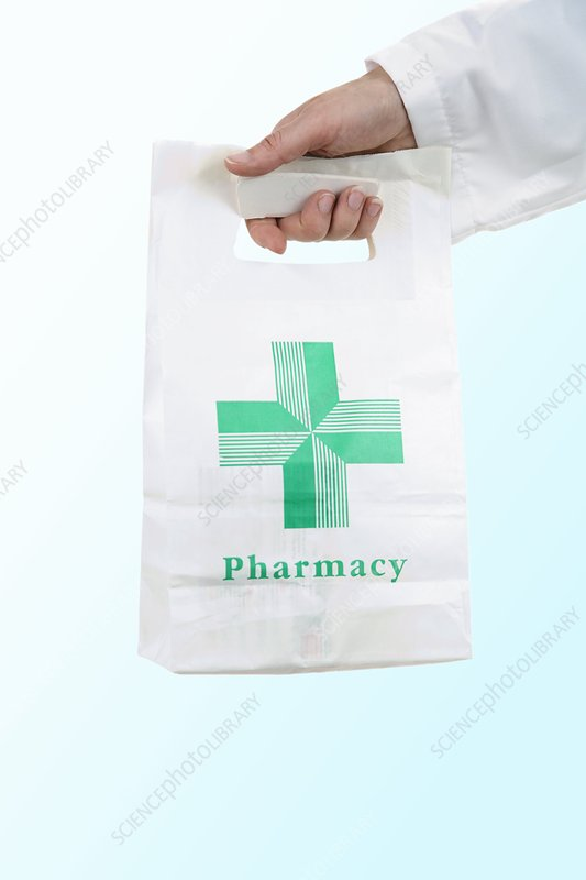Pharmacist carrying a pharmacy bag