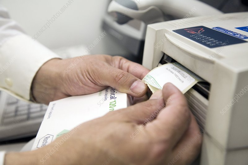 Pharmacist scanning a barcode