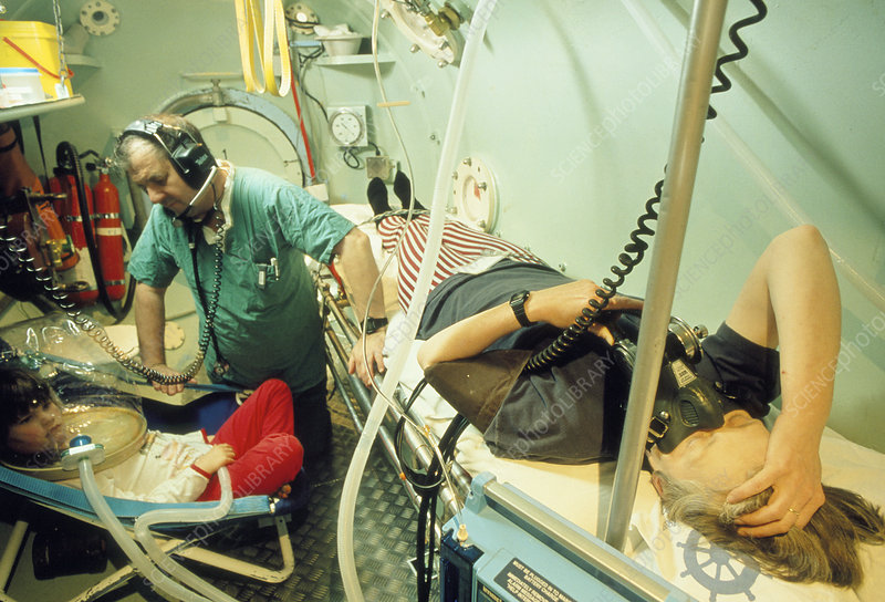 Mother and child receive hyperbaric oxygen therapy
