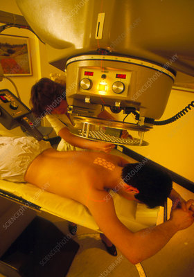 Patient being treated with radiotherapy