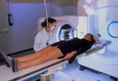 Woman patient being prepared for radiotherapy