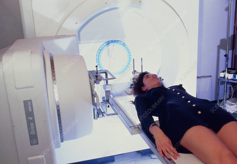 Woman aligned on radiotherapy machine