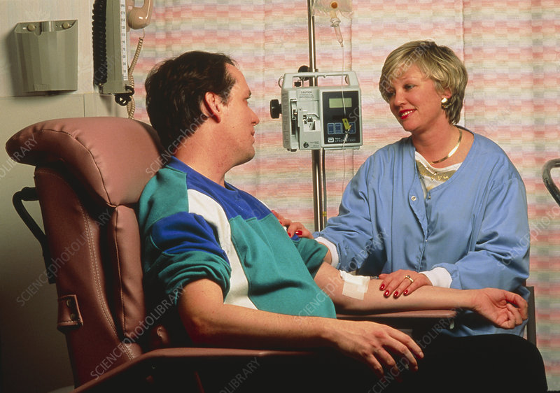 Chemotherapy: seated man with IV drip in arm