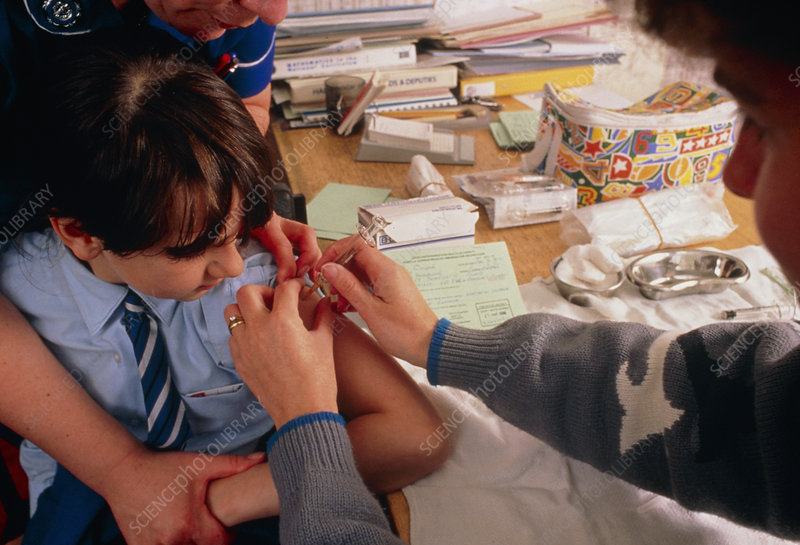 Schoolgirl being vaccinated against rubella