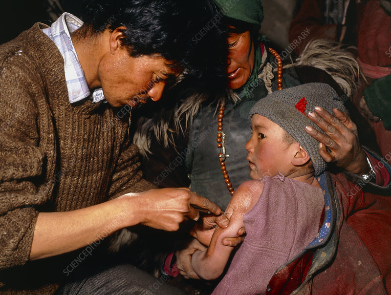 Child being given measles vaccine, India