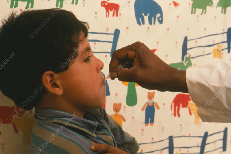Schoolboy receiving oral vaccination
