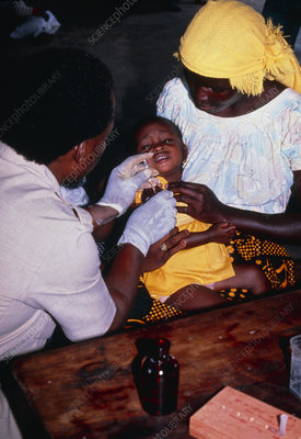 Child being vaccinated against malaria, Tanzania