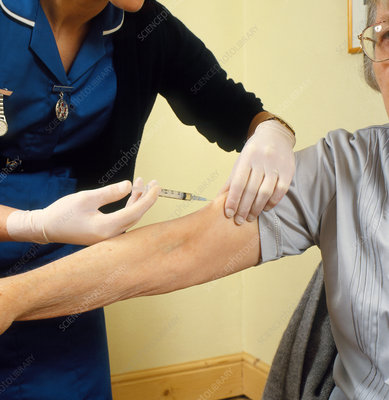 Elderly woman given injection by district nurse