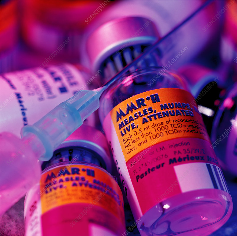 Assorted bottles of MMR vaccine and a syringe