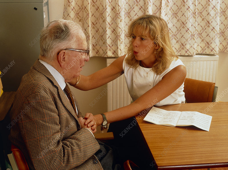 Speech therapist with old male patient