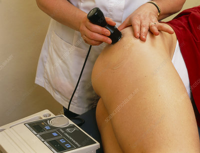 Physiotherapist treats haematoma with ultrasound