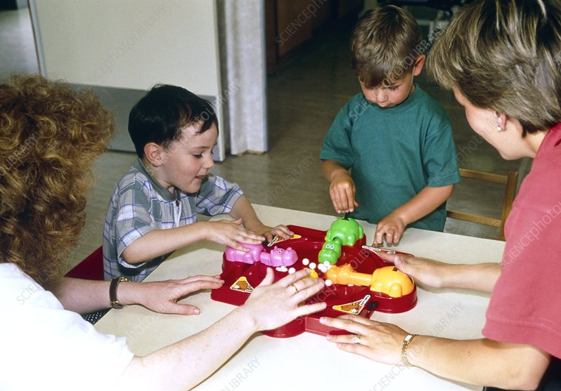 Children playing with toy in occupational therapy