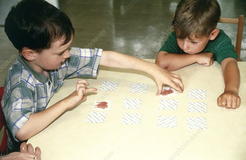Children playing cards during occupational therapy