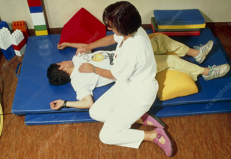 Physiotherapist with cystic fibrosis patient