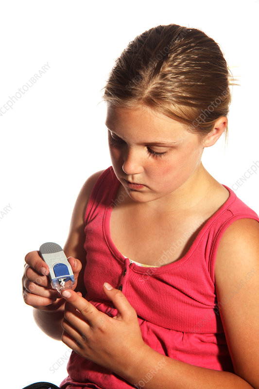 Diabetic Child with Blood Glucose Tester