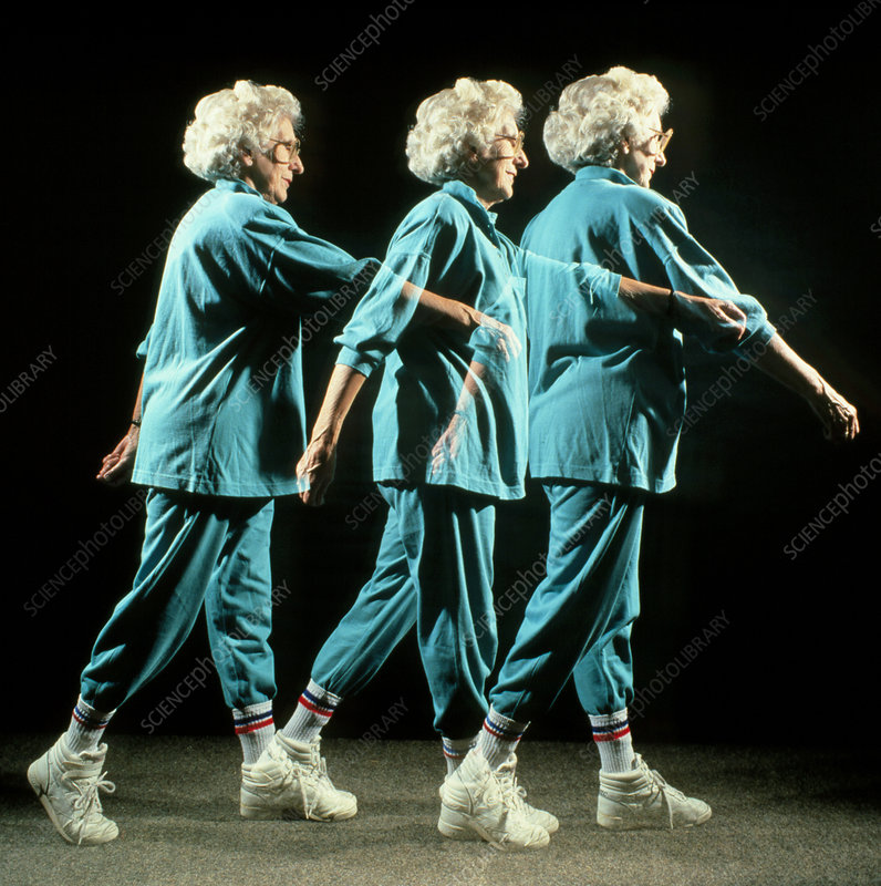 Elderly woman performing walking exercise