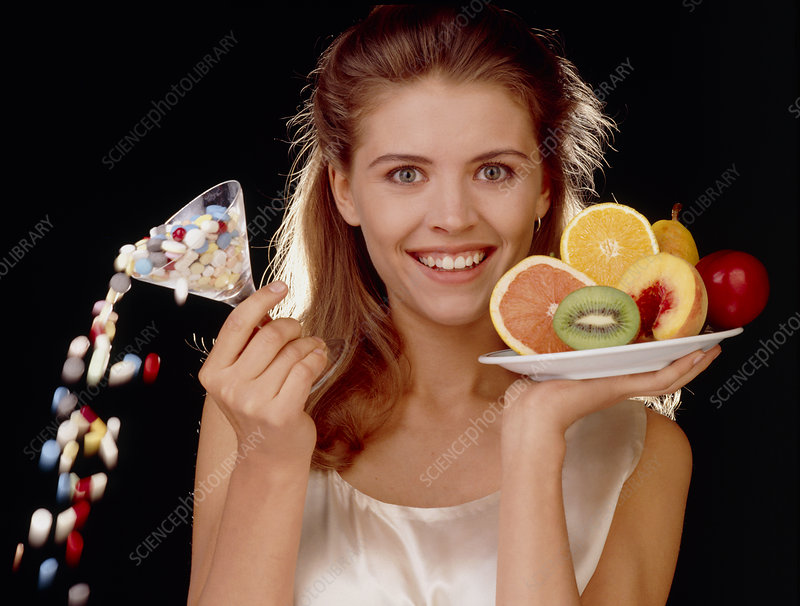 Woman giving up pills for healthy food