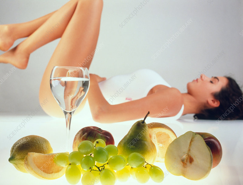 Health and beauty: woman with fresh fruit