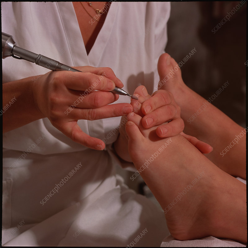 Woman's foot receiving a pedicure