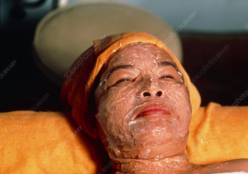 Woman wearing a face pack for beauty therapy