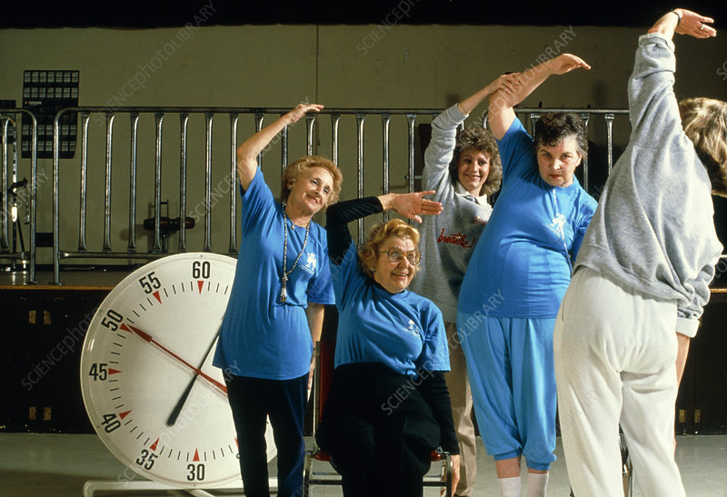 Elderly women attend an aerobics exercise class