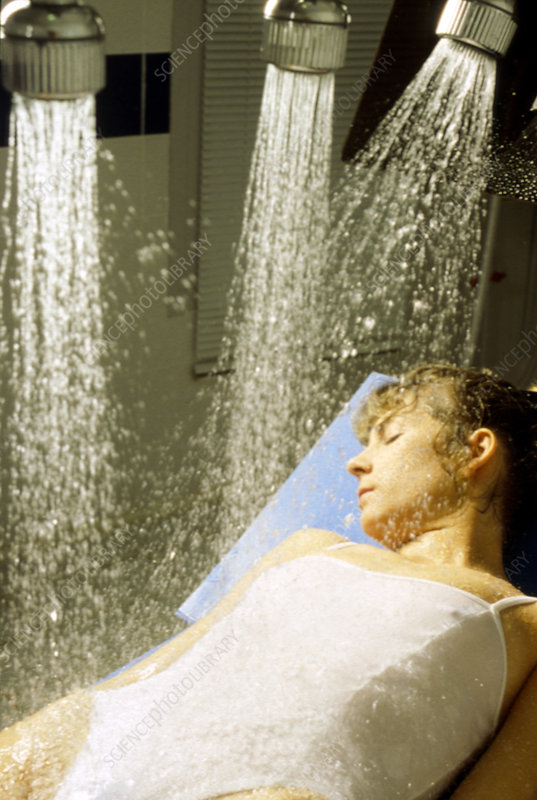 Woman under hydrotherapy showers