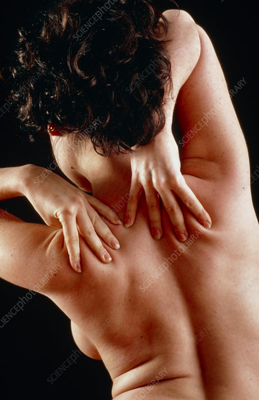 Woman affected by shoulder pain doing self-massage