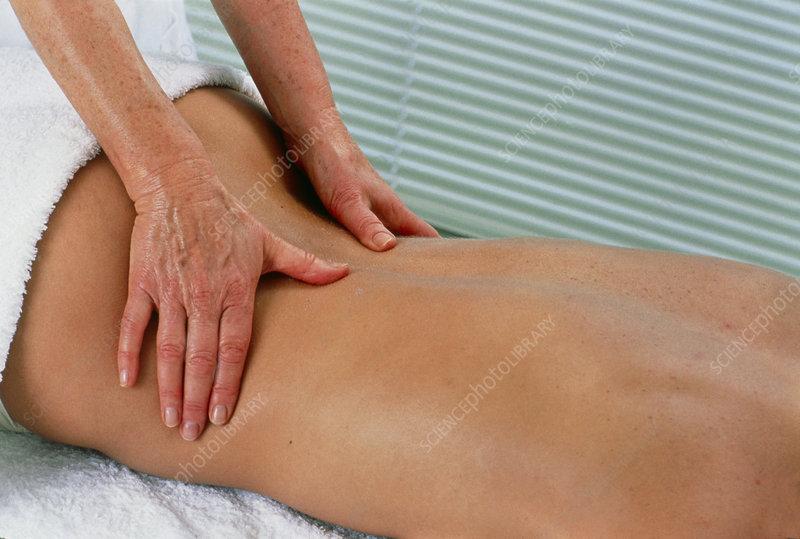 Woman undergoing a back massage