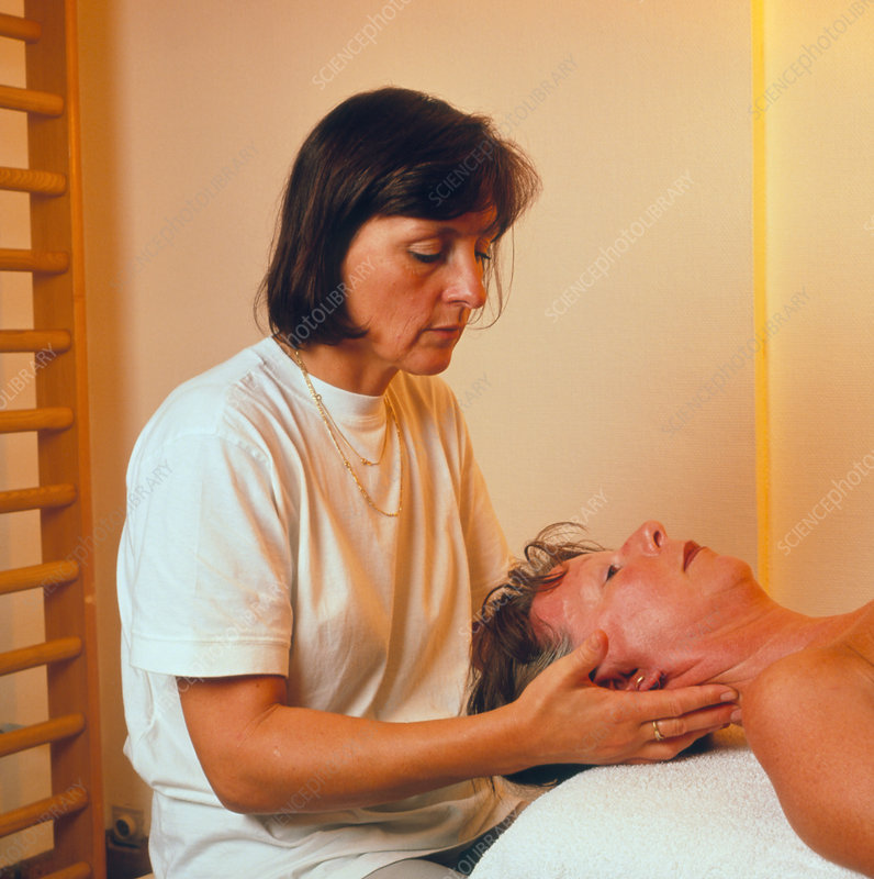 Woman having her neck massaged