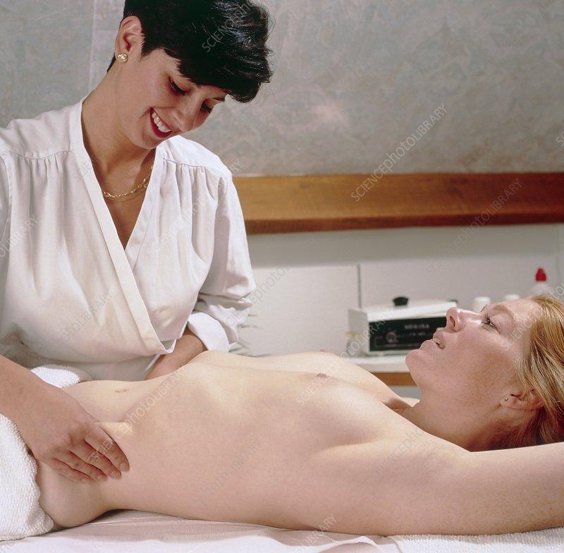 Woman has her abdomen massaged by a masseuse