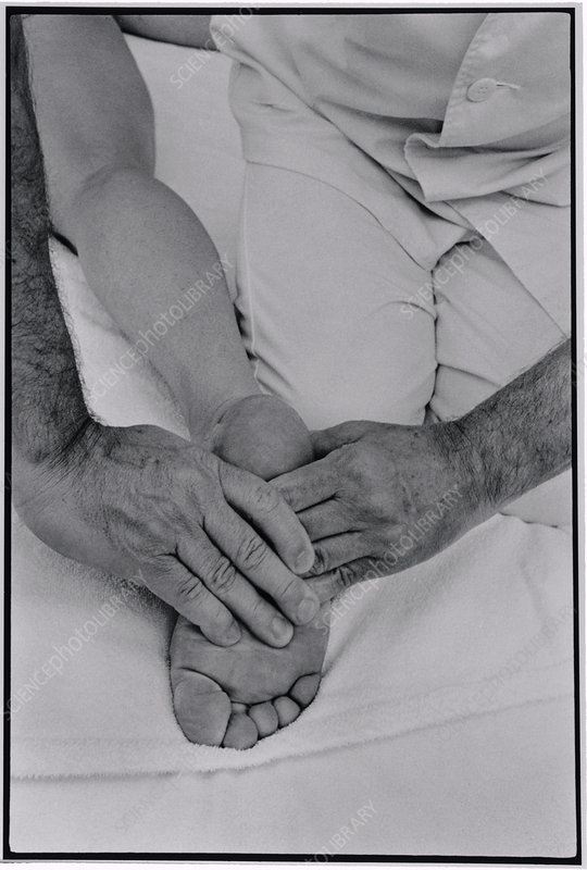 Foot of a woman receiving shiatsu massage