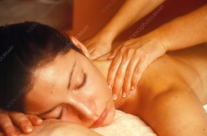Woman receiving neck and shoulder massage