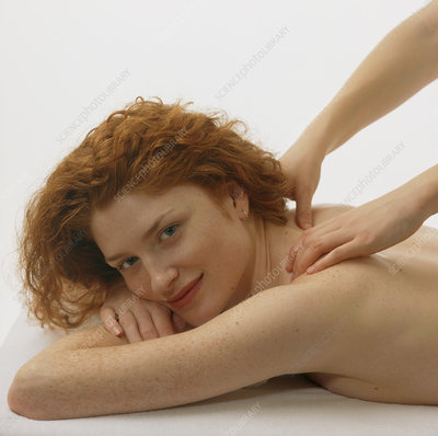 Woman receives a neck and shoulder massage