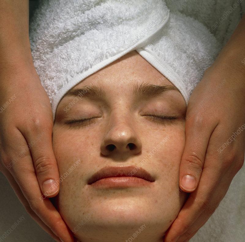 Woman receives a facial massage