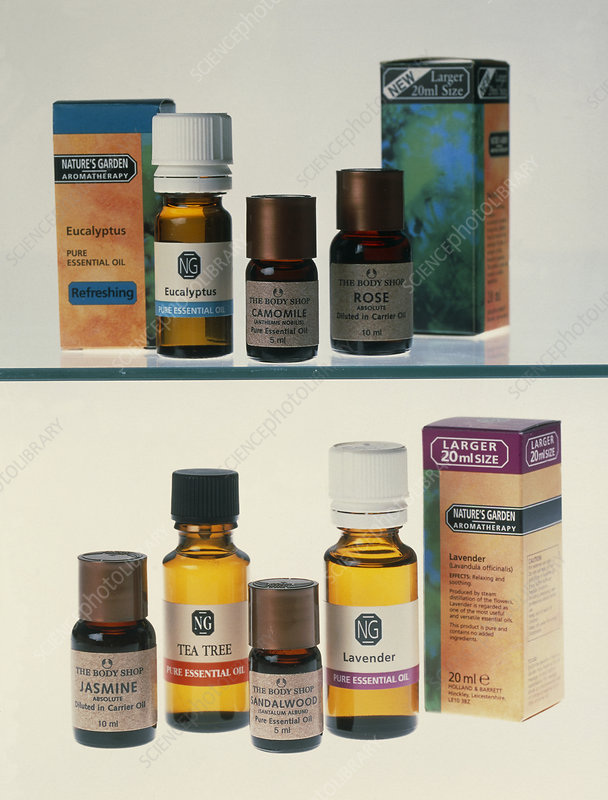 Bottles containing aromatherapy oils in a cabinet